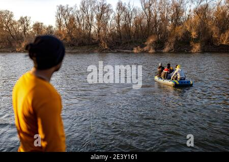 Syrian, Afghan, and other refugees prepare their boats to cross the Greek border from Turkey - Stock Photo