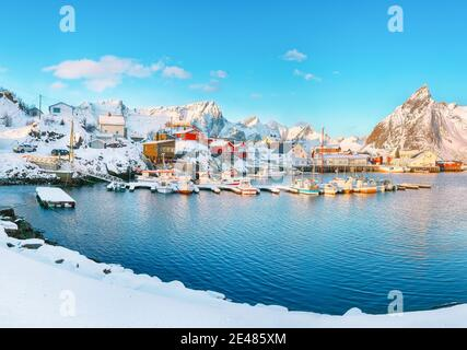Fantastic winter view on Hamnoy village with port and  Olstinden peak on background.  Location: Hamnoy,  Moskenesoya , Lofoten; Norway, Europe - Stock Photo
