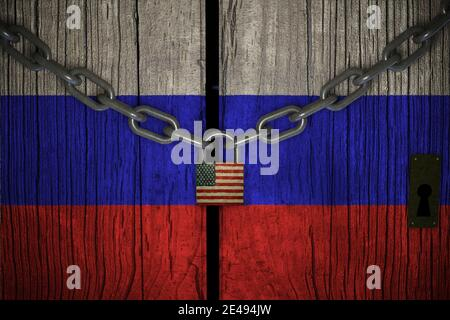 Flag of Russia painted on old and cracked wooden door, which is closed by an old chain and a padlock. Concept of the economic sanctions of the United - Stock Photo