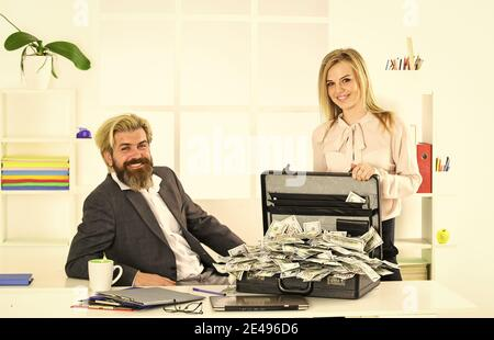 lack of money. corporate leather bag. business couple with case at workstation. happiness and success. partners holding briefcase. suitcase with money. good deal. modern life and business. - Stock Photo