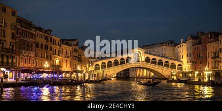 Venice during Corona times without tourists, illuminated Rialto Bridge