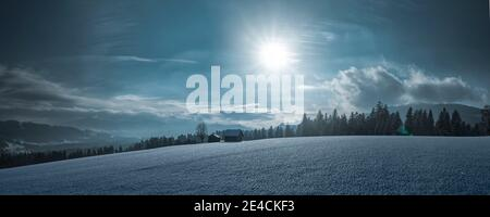 Snowy winter landscape with a lonely wooden hut - Stock Photo
