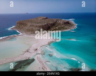 Crete Greece, Balos lagoon on Crete island, Greece. Tourists relax and bath in crystal clear water of Balos beach. Greece