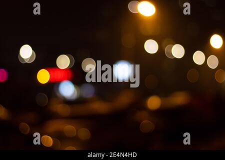 Abstract blurred image of bokeh lights in the city