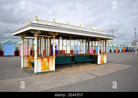 Brighton seafront shelter with beach huts, Sussex, UK