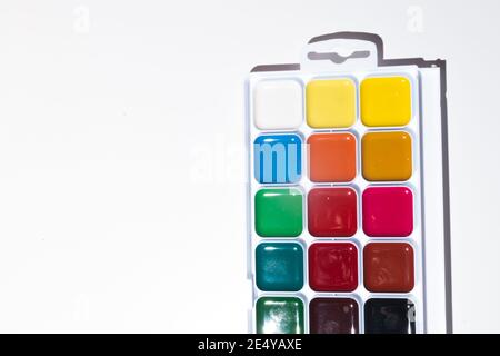 Top view of set of watercolor paints  in a box, isolated on white. Back to school concept. Concept for a painting school or art store. Hobby concept f