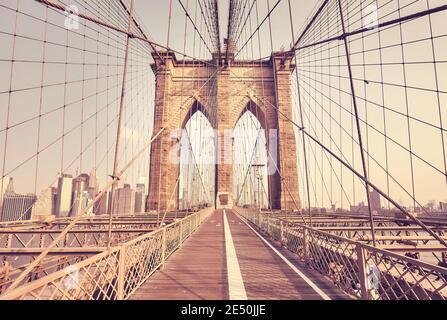 Retro color toned picture of Brooklyn Bridge, New York City, USA.
