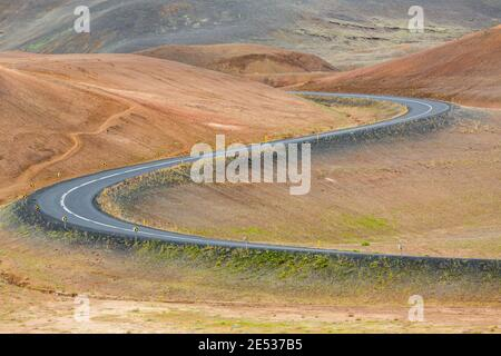 Close up of the iconic icelandic Route 1 snaking through the red volcanic landscape