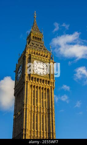 A picture of the upper section of the Big Ben, part of the Palace of Westminster. - Stock Photo