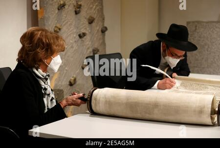 Vice President of the European Jewish Congress and the World Jewish Congress Charlotte Knobloch holds the Etz Chaim as Rabbi Shaul Nekrich completes the historic Sulzbach Torah Scroll from 1792, rediscovered in 2013 and just restored, during a ceremony marking the 76th anniversary of the liberation of Nazi Germany's Auschwitz death camp, on International Holocaust Remembrance Day, at the Bundestag, in Berlin, Germany, January 27 , 2021. Odd Andersen/Pool via REUTERS - Stock Photo