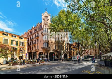 PALMA, SPAIN - APRIL 11, 2019: People walking on the street in the city center of Palma - aka Palma de Mallorca.