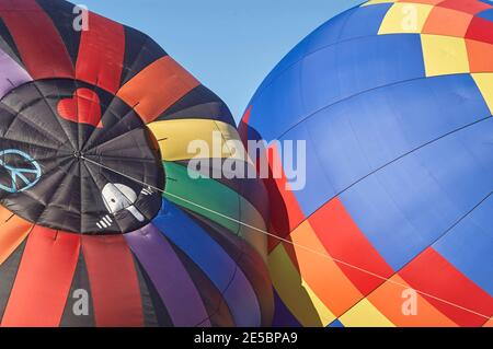 Two Hot Air Balloons being inflated - Stock Photo