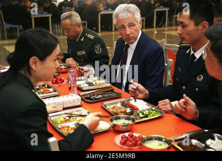 U.S. Secretary of Defense Chuck Hagel (C) has lunch with students at the mess hall of the Non-Commissioned Officer Academy during a tour in Changping April 9, 2014. Secretary Hagel is on the second stop of an Asian trip, the fourth time since he took office, to Japan, China and Mongolia.  REUTERS/Alex Wong/Pool  (CHINA - Tags: MILITARY POLITICS EDUCATION)