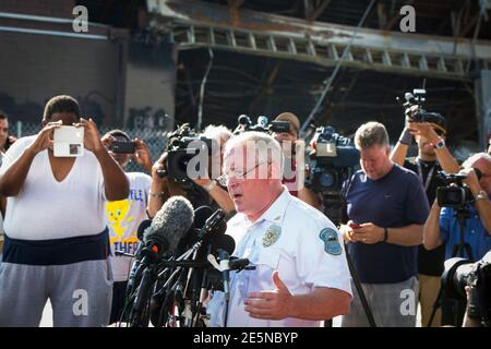 Ferguson Police Chief Thomas Jackson announces the name of the officer involved in the shooting of Michael Brown as officer Darren Wilson, in Ferguson, Missouri August 15, 2014. The briefing was held near a QuikTrip convenience store that had been burned amid protests over the shooting of Brown, 18, last Saturday. REUTERS/Lucas Jackson (UNITED STATES - Tags: CIVIL UNREST CRIME LAW)