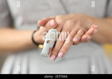 Orthopedic orthosis fixing joints of hand finger closeup - Stock Photo