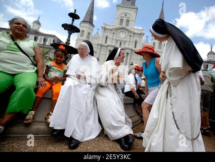 Dominican Sisters at the St. Louis Cathedral Academy enjoy ice cream during the 29th annual French Quarter Festival in New Orleans, Louisiana April 14, 2012. More than 500,000 people are expected to pack the French Quarter this weekend. REUTERS/Sean Gardner (UNITED STATES - Tags: SOCIETY) Stock Photo