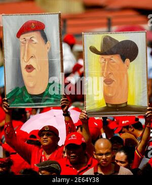 Supporters of Venezuelan President Hugo Chavez holds a portraits of him during a rally to commemorate Labour Day in Caracas May 1, 2011. REUTERS/Jorge Silva (VENEZUELA - Tags: POLITICS EMPLOYMENT BUSINESS)