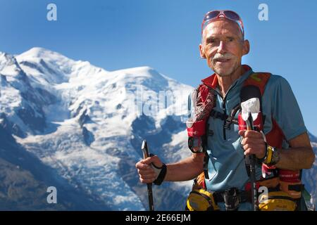 71 year old Swiss runner Werner Schweizer poses with Mont-Blanc in the background as he trains ahead of the Ultra-Trail du Mont-Blanc (UTMB) at Les Flegeres in Chamonix August 26, 2010. The 8th race which started on August 27 was due to circle around the highest peak in Europe passing from France into Italy and Switzerland. With a total of 166 km, the race was cancelled a few hours after the start due to difficult weather conditions. Schweizer, who finished all seven previous UTMB races, said 'it was reasonable to stop the race' but told of his bitter disappointment after months of intensive t