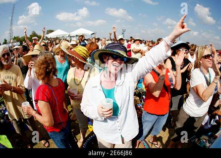Carol Kolinchak (C) dances while musician Kermit Ruffins performs during the 29th annual French Quarter Festival in New Orleans, Louisiana April 14, 2012. More than 500,000 people are expected to pack the French Quarter this weekend. REUTERS/Sean Gardner (UNITED STATES - Tags: ENTERTAINMENT SOCIETY TRAVEL) Stock Photo