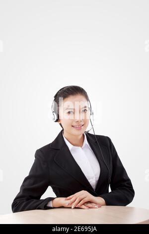 Oriental business lady wearing headset high quality photo