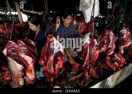 Women sell beef at the Myitkyina market in the capital city of Kachin State, northern Myanmar February 23, 2012.  REUTERS/Soe Zeya Tun (MYANMAR - Tags: SOCIETY) Stock Photo