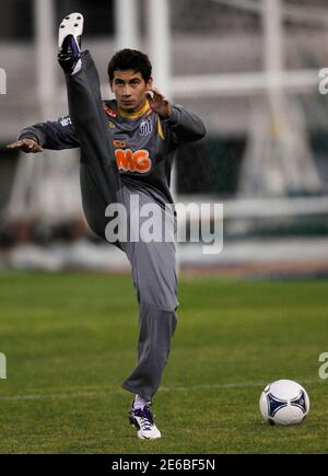 Ganso of Brazil's Santos stretches during a training session for the FIFA Club World Cup Japan 2011 in Toyota, central Japan December 9, 2011.  REUTERS/Kim Kyung-Hoon (JAPAN - Tags: SPORT SOCCER)