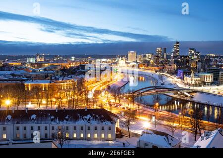 Vilnius, capital of Lithuania, beautiful scenic aerial panorama of modern business financial district architecture buildings with river and bridge