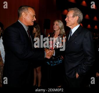 Director of the movie Clint Eastwood (R) greets cast member Tom Hanks at the premiere of 'Sully' in Los Angeles, California U.S., September 8, 2016.   REUTERS/Mario Anzuoni