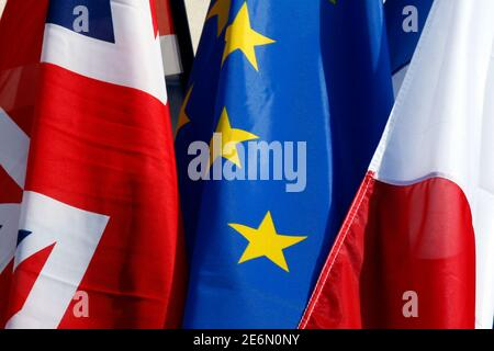 French flag, British Union Jack flag and European flag fly on the Amiens city hall during a Franco-Britain summit in Amiens, northern France, March 3, 2016. REUTERS/Philippe Wojazer