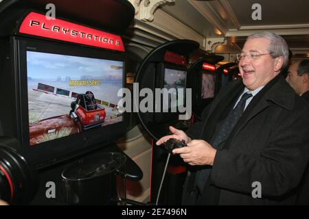 President of the Ile de France region Jean-Paul Huchon attends the Launch party of Sony's new PlayStation 3 hosted by 'La FNAC' near the 'Effel Tower' in Paris, France, on March 22, 2007. Sony launched its new game console at midnight, which can play movies on DVD 'Blue Ray', music and games, across Europe. Photo by Benoit Pinguet/ABACAPRESS.COM - Stock Photo