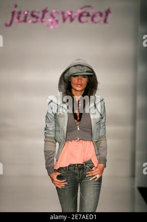 A model presents a creation from the Justsweet collection by Jennifer Lopez during Fashion Week in Miami Beach, Florida, March 23, 2006. Photo taken March 23, 2007.   REUTERS/Carlos Barria (UNITED STATES)