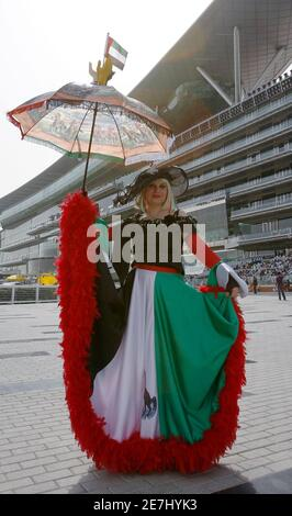 Katharina Dietrich of Germany poses with her umbrella ahead of the Dubai World Cup March 27, 2010. The Dubai World Cup, with a cash prize of $10 million, is horse racing's richest prize. REUTERS/Caren Firouz (UNITED ARAB EMIRATES - Tags: SPORT HORSE RACING) - Stock Photo