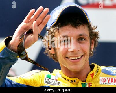 MotoGP rider Valentino Rossi of Italy waves after winning the race at the Catalonia Motorcycling Grand Prix in the Montmelo racetrack near Barcelona June 18, 2006. - Stock Photo