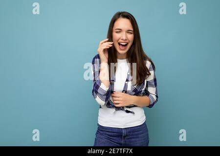 Photo shot of cute nice charming gorgeous attractive pretty youngster happy woman wearing stylish clothes isolated over colorful background with copy