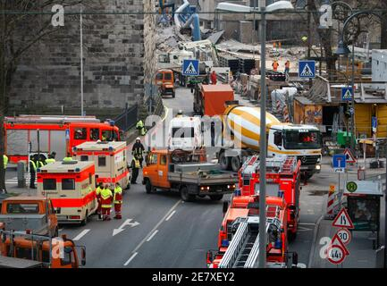 Members of the emergency services gather near to the collapsed building of the town archive of the German city of Cologne, March 3, 2009. More than 200 rescue workers rushed to the scene in the south of the city after the collapse of the multi-storey building, which German media said may have been sparked by work on an underground train line.  At least one person was injured and possibly others are trapped inside, a Cologne police spokesman said, adding the cause for the collapse was still unclear. In background is Cologne Cathedral.     REUTERS/Ina Fassbender   (GERMANY) - Stock Photo