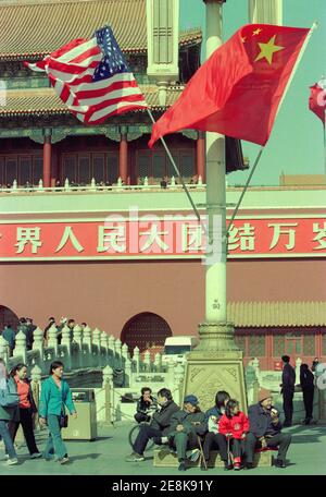 The Chinese and American flags fly over the area around Tiananmen Square during the days when American President George W. Bush visits China. 2002