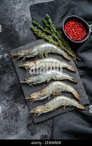 Fresh raw giant langoustine shrimp. Black background. Top view