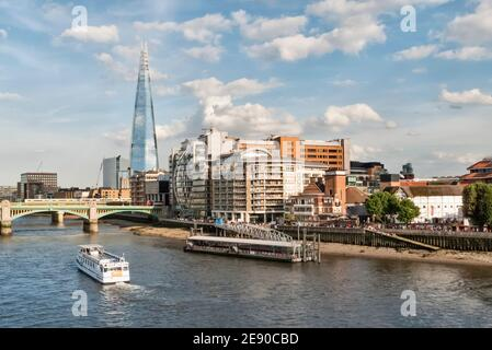 London skyline: the Shard, Riverside House, Southwark Bridge and Bankside Pier on the River Thames on a sunny day in summer - Stock Photo