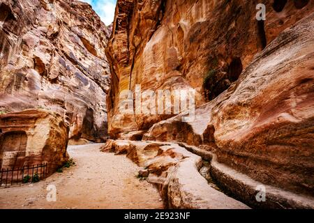 The Siq, a miracle narrow stone gallery in mysterious Petra, Jordan