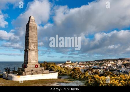 FINDOCHTY MORAY COAST SCOTLAND IMPOSING WAR MEMORIAL OVERLOOKING THE HARBOUR ON A FROSTY MORNING A WHITE CHURCH  ON THE HILL