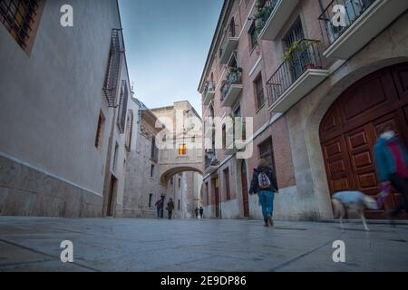 Valencia Spain on December 10, 2020: The arch of the cathedral by evening Barchilla street.