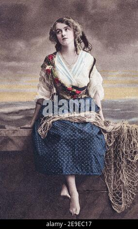 A studio depiction of a fisher girl or fishwife on a coloured real photogravure postcard posted in 1913. - Stock Photo