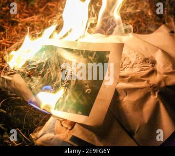 Burning portrait of Burma Army Commander-in-Chief Min Aung Hlaing in protest against the military coup.Myanmar's military detained State Counsellor of Myanmar Aung San Suu Kyi on February 01, 2021 and declared a state of emergency while seizing the power in the country for a year after losing the election against the National League for Democracy (NLD).