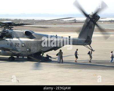 U.S. citizens exit a U.S. Marine Corps CH-53 helicopter assigned to the 24th Marine Expeditionary Unit in Cyprus, following their departure from the U.S. Embassy in Beirut, Lebanon on July 16, 2006. At the request of the U.S. Ambassador to Lebanon and at the direction of the Secretary of Defense, the United States Central Command and U.S. Marines are assisting with the authorized departure of U.S. citizens from Lebanon. Photo by USN via ABACAPRESS.COM