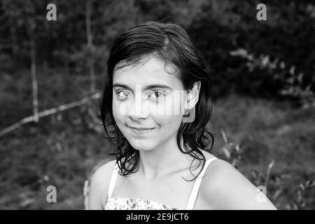 Portrait of teengirl in the park outdoors. Black and white photo. - Stock Photo