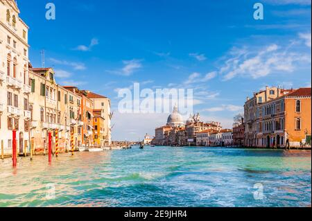 The Grand Canal and its facades and the Basilica of Santa Maria della salute in the background in Venice in Veneto, Italy