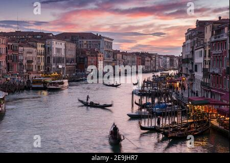 Traffic on the Grand Canal from the Rialto Bridge at sunset in Venice, Veneto, Italy