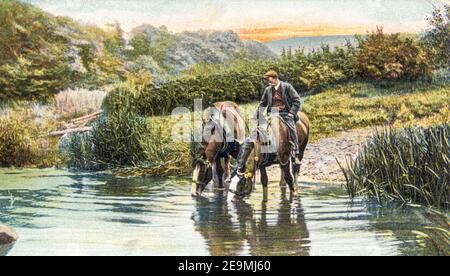 Watering the Horses in the Rural Life series of postcards produced by Raphael Tuck in the early 20th century. - Stock Photo