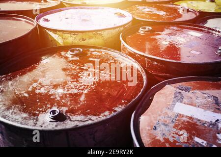 Danger old rusty oil fuel toxic chemical steel tank container in port warehouse cargo. - Stock Photo