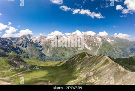 Aerial drone view of Grossglockner mountain range with serpentine high alpine road in Austria